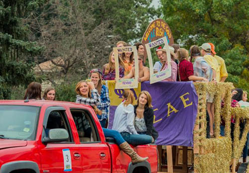 Mines students riding in a float for Homecoming 2015