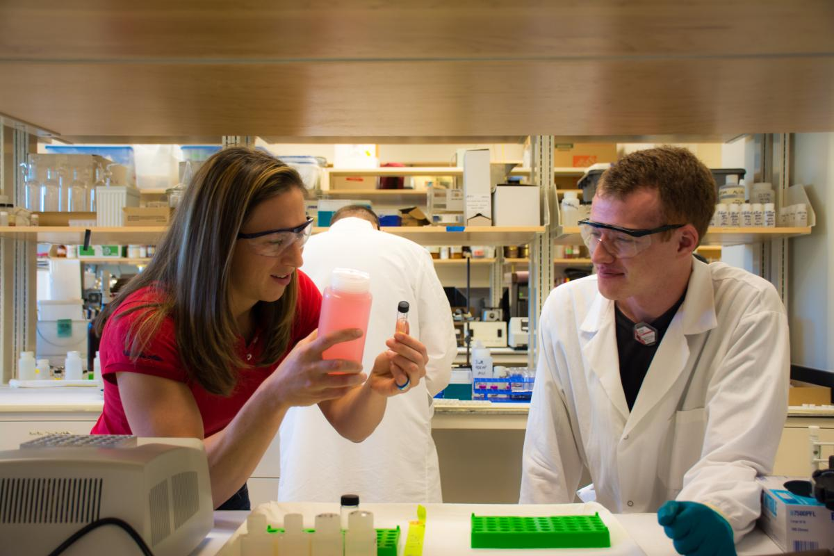 Student Nathan Bessen talks to Jenifer Braley in the radiochemistry lab