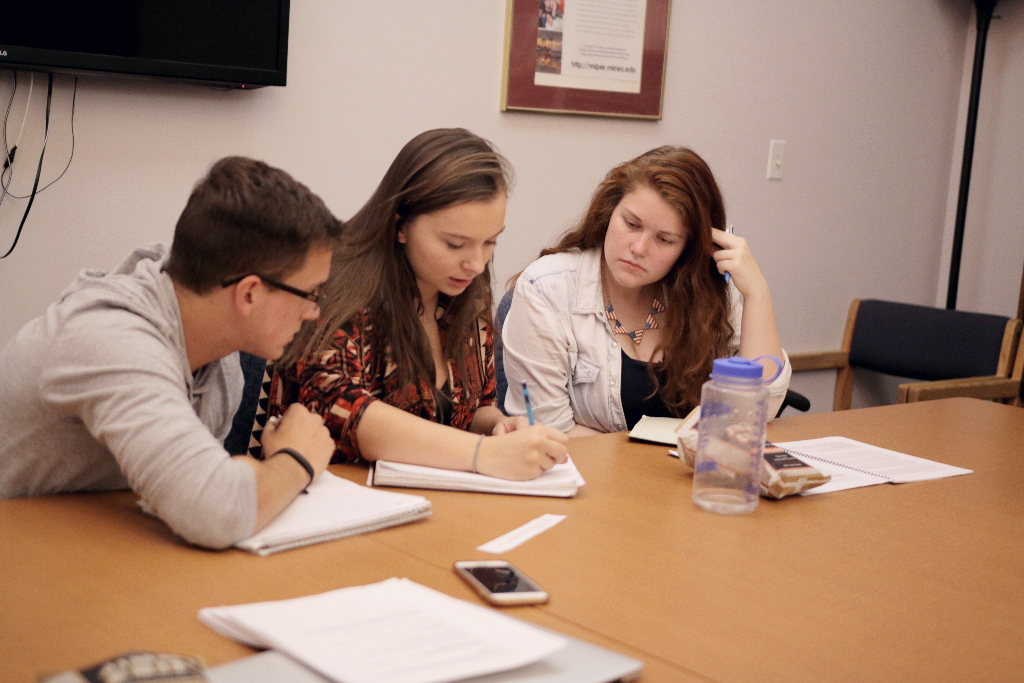 The team forms an argument during an evening practice leading up to the regional competition.