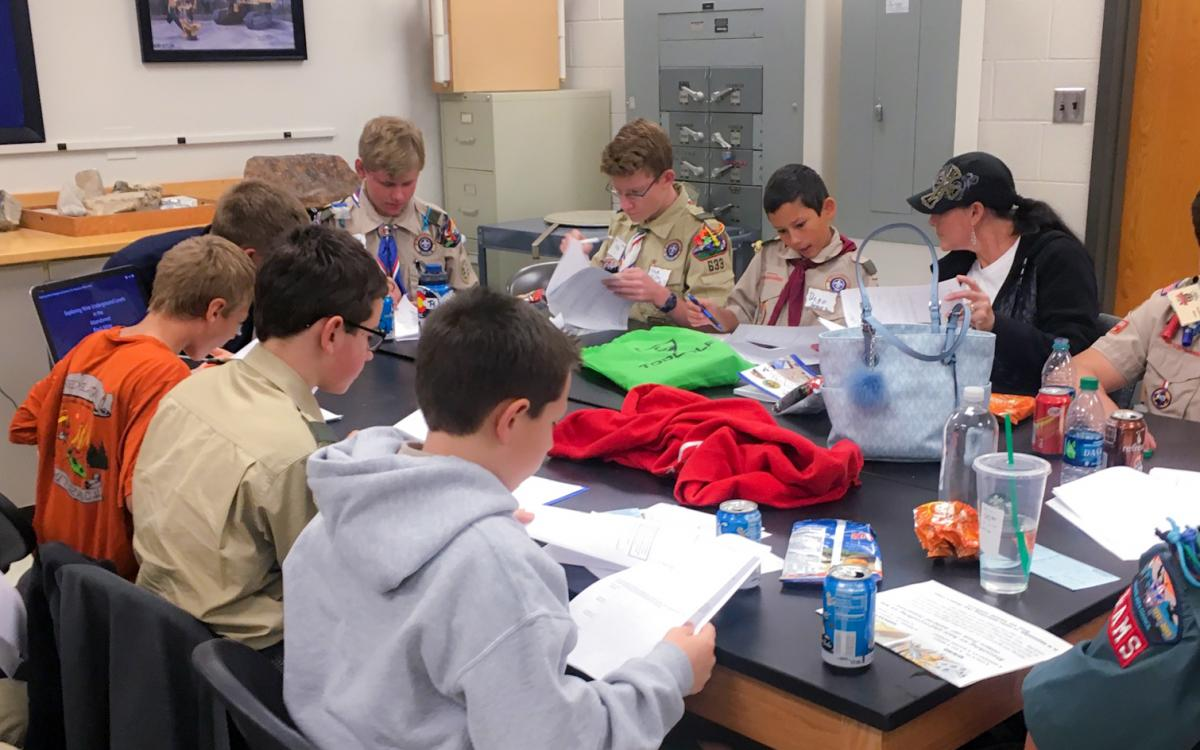 Boy Scouts working to earn their Mining in Society merit badges with SME at Mines.
