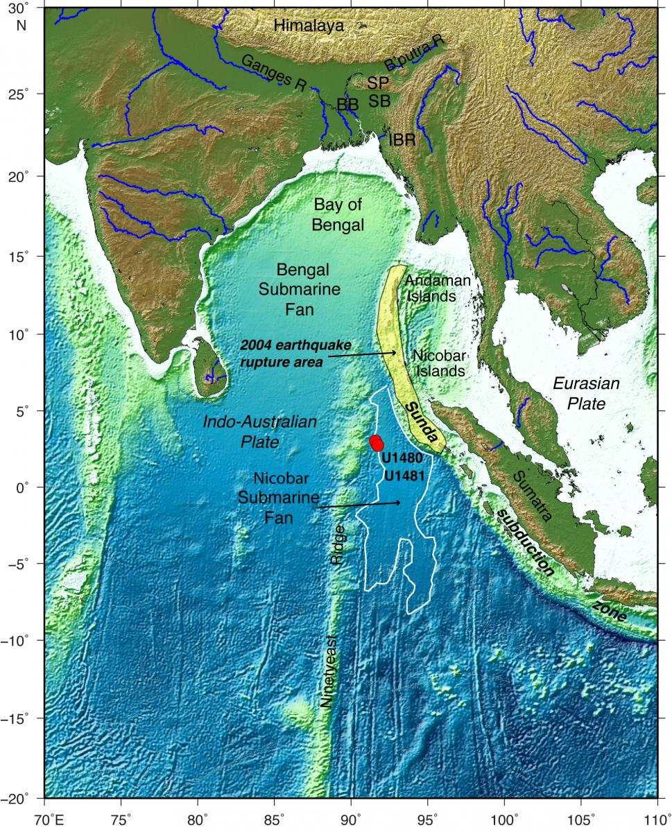 Map of the eastern Indian Ocean and surrounding regions. Location of the drilling expedition and the Sunda subduction zone also shown. The Indo-Australian plate subducts beneath the Eurasian plate at the subduction zone and it was the source of the 2004 earthquake and tsunami offshore Sumatra to Andaman Islands (rupture area shaded in yellow). Ocean drilling boreholes are red dots (U1480, U1481). The Bengal and Nicobar submarine fans are fed by river sediments eroded from the Himalaya and Tibetan Plateau, creating very large thicknesses of sediment. (Credit: Lisa McNeill, University of Southampton.)