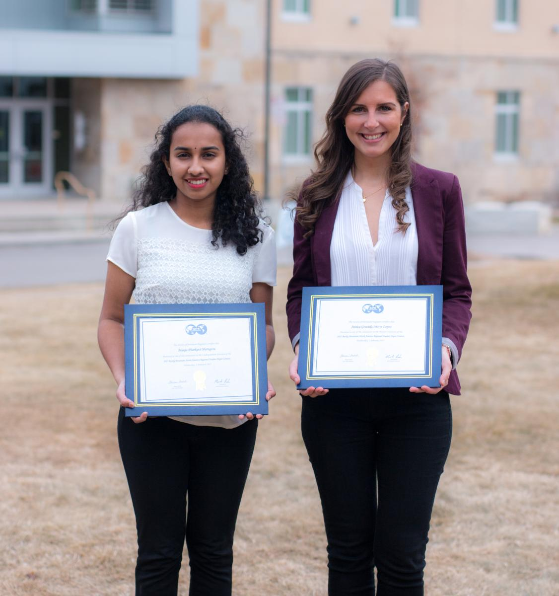 Manju and Jessica with their award plaques.