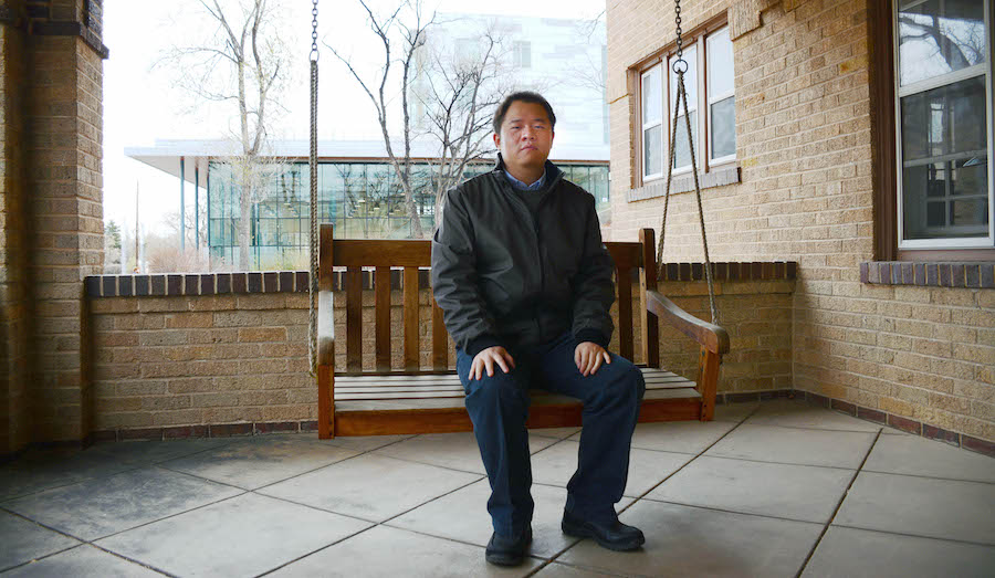 Rui Zhao sits on the swing on the porch of Coolbaugh House at Mines.