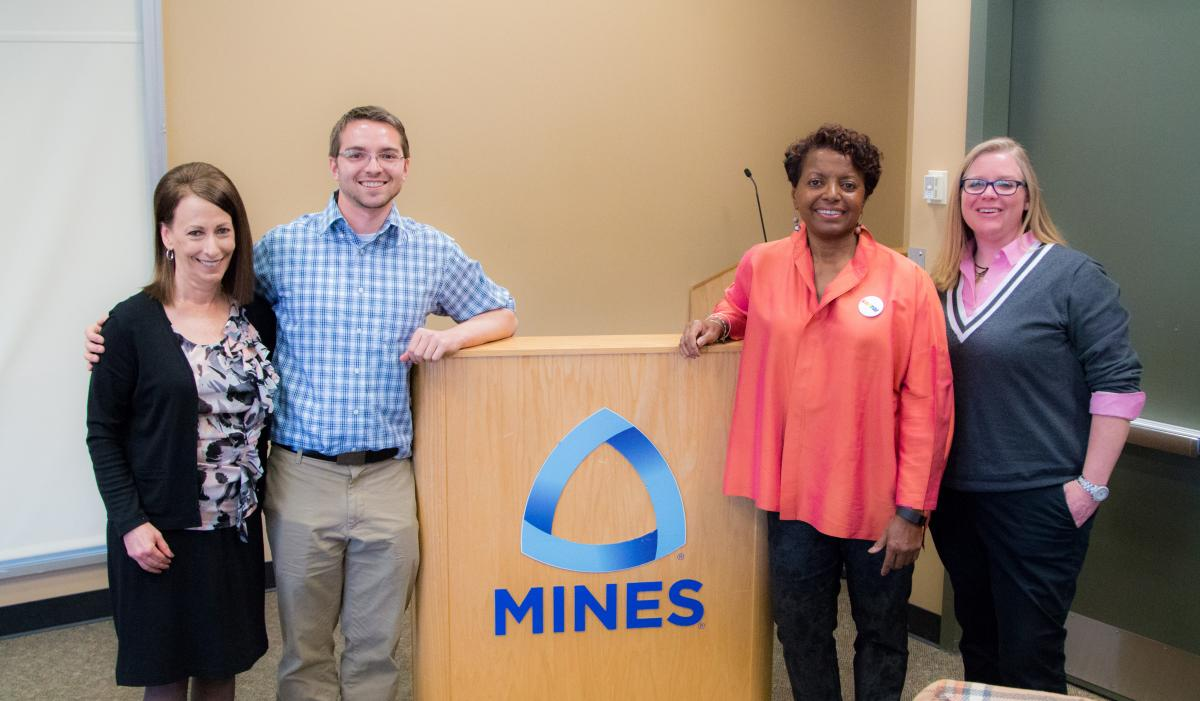 The organizers of the event with the speaker. Left to right: Deb Lasich, Associate Vice President for Diversity and Inclusion at Mines; Petere Weddle, President of oSTEM at Mines; Faye Tate, Director of Global Diversity, Equality, and Inclusion for CH2M; and Kim Pattillo, CH2M University Relations.