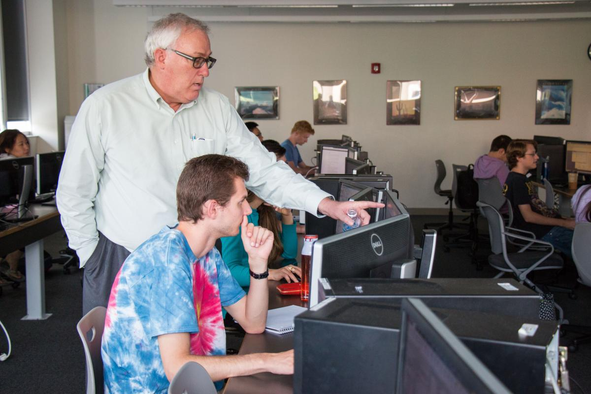 Tom Bratton teaches students how to use well-modeling software used in the industry.