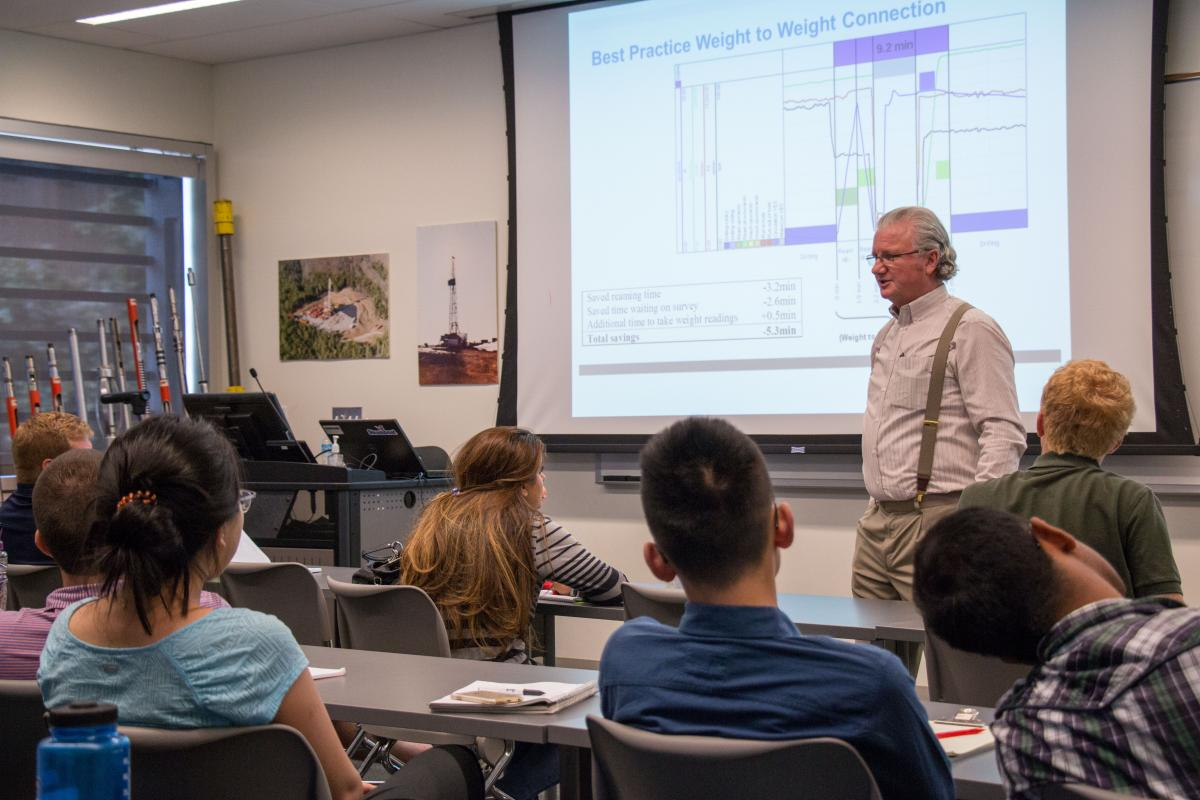 Students in Drilling and Production Data Analytics externship learn from industry rep John de Wardt.