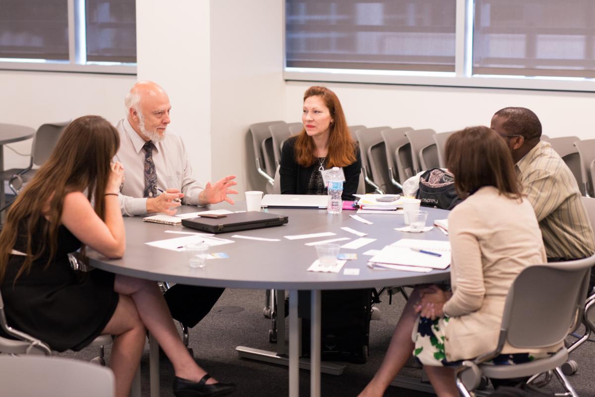 Faculty students and industry members brainstorm strategies for increasing CSR education for engineers.