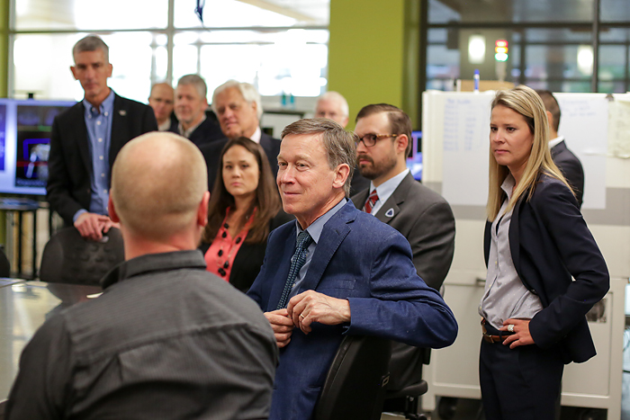 Gov. Hickenlooper listens as Research Associate Professor Branden Kappes describes the work of ADAPT.