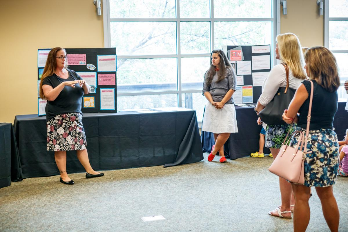 Teachers present what they've learned at the final poster showcase.